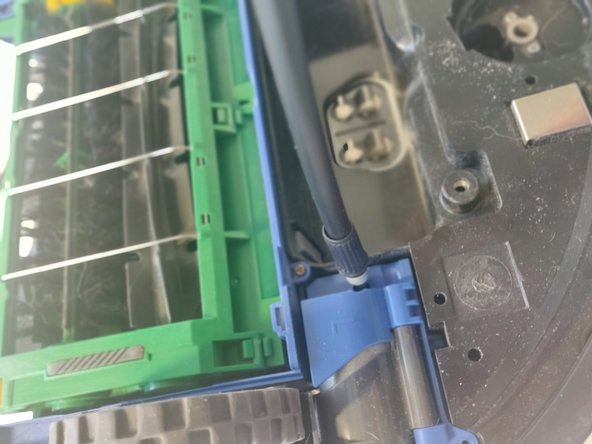 Using the Phillips #1 driver, remove the three screws that hold back the wheel unit on each side. This is not required but will make the repair easier.
