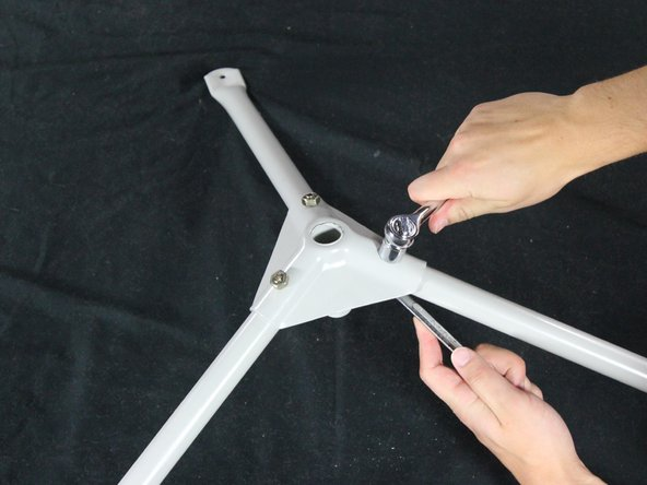 Tighten each nut using two 14mm wrenches until each leg is stable and the tripod will stand on its own.