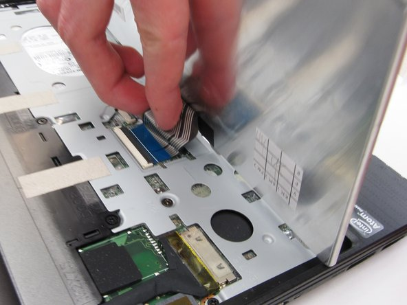 Look at the intel sticker in this step and the previous step to orient your computer with the pictures.