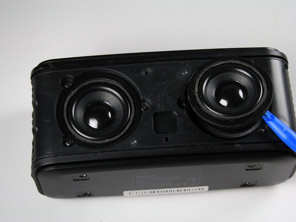 Use the Plastic Opening Tool to gently lift the speaker enough to see the connected wires.