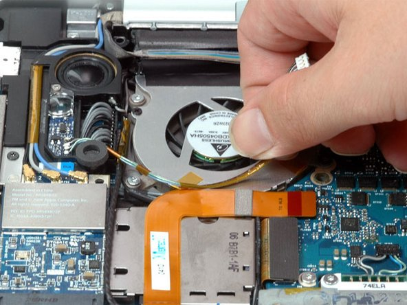 Peel up the left ambient light sensor cable from above the left fan, removing tape as necessary.
