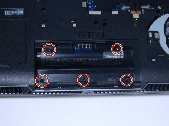Remove the 5 screws circled in the picture, located where the battery pack once was.