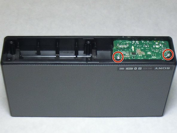 Locate the remaining two 3.5 mm screws on the bottom of the I/O board and remove them using a Phillips head #2 screwdriver.