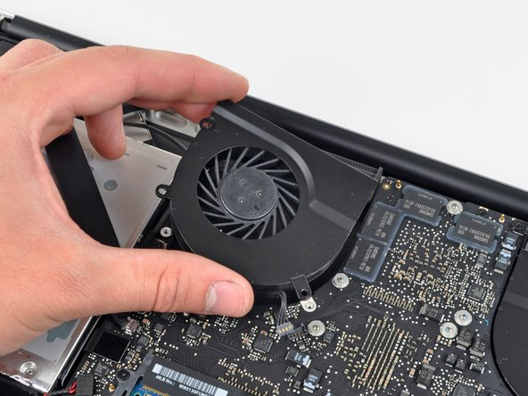 Lift the right fan out of the upper case.