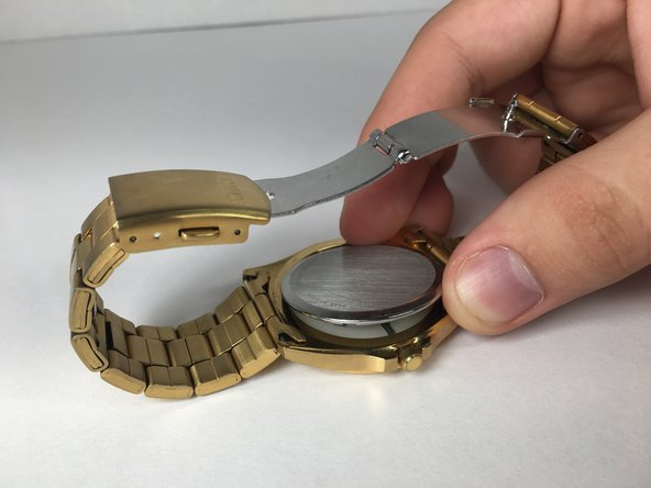 Press the back cover on the watch using hands or clamp, until it pops into place.