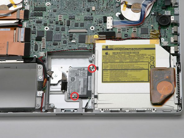 Remove the two black Phillips screws from the modem board.