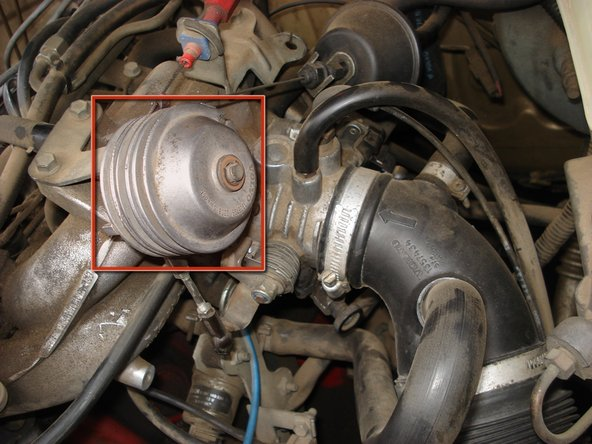 Locate throttle linkage cable assembly.