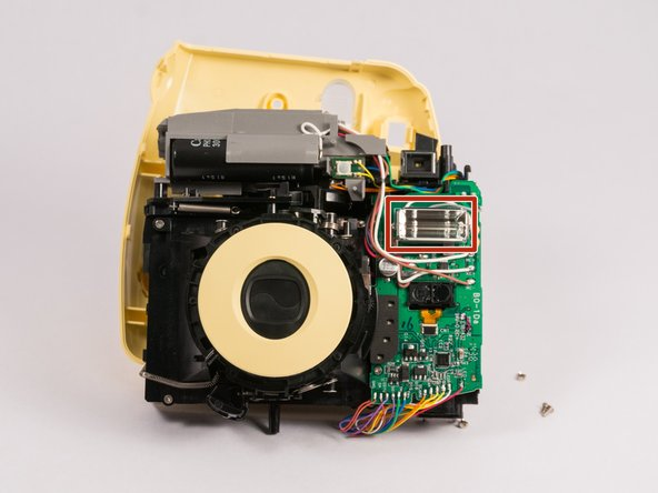 You should now be able to see the flash unit. Take care to not touch the large black capacitor on the top. It will still have a charge and will hurt.