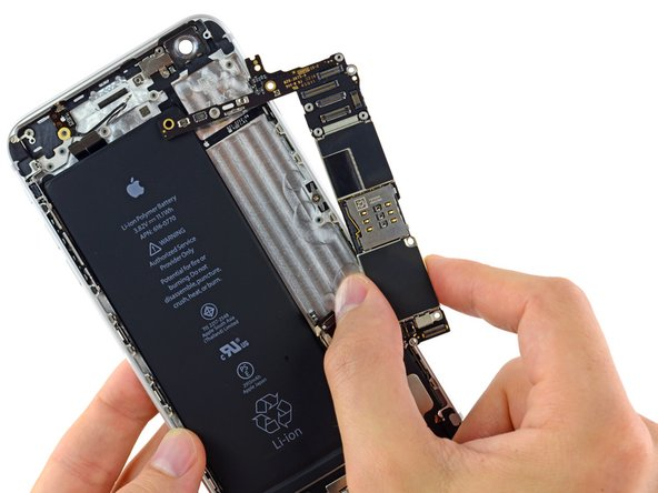 Lift and remove the logic board out of the iPhone.