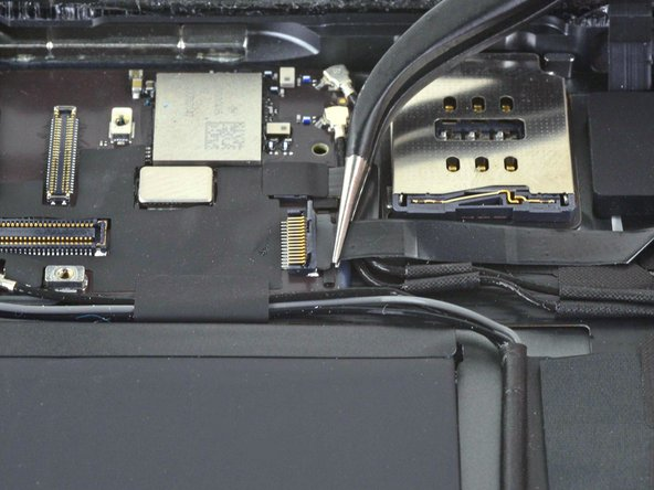 Use a pair of tweezers to carefully pull the home button ribbon cable straight out of the ZIF connector.