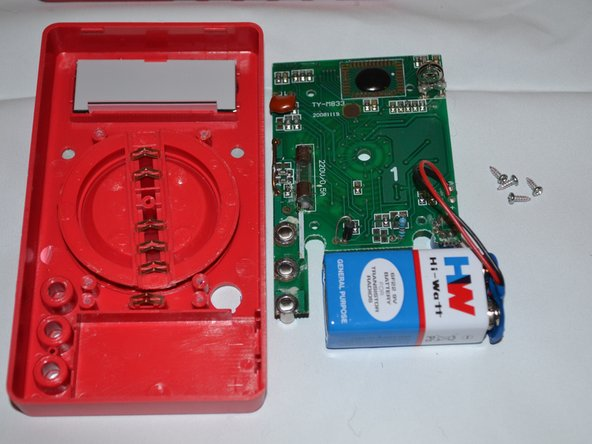 Gently lift the circuit board away from the device casing.