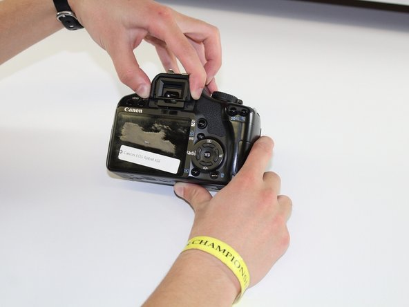 Squeeze the eyepiece between your index finger and thumb and lift up and off