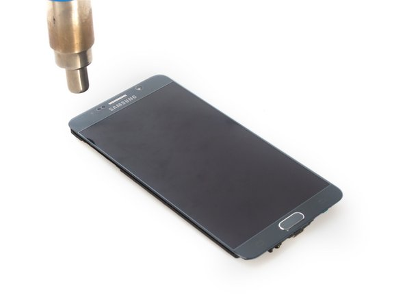 Remove LCD screen. It's really difficult, see more details on Samsung Galaxy Note 5 teardown.