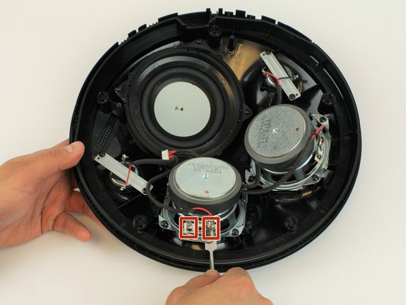 Using the metal spudger, gently pry off the two red and black connectors.