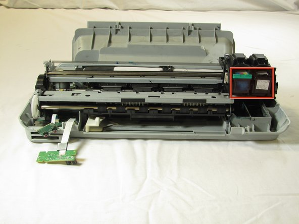 Remove both of the ink cartridges by grabbing the front of the ink cartridge and pulling down.