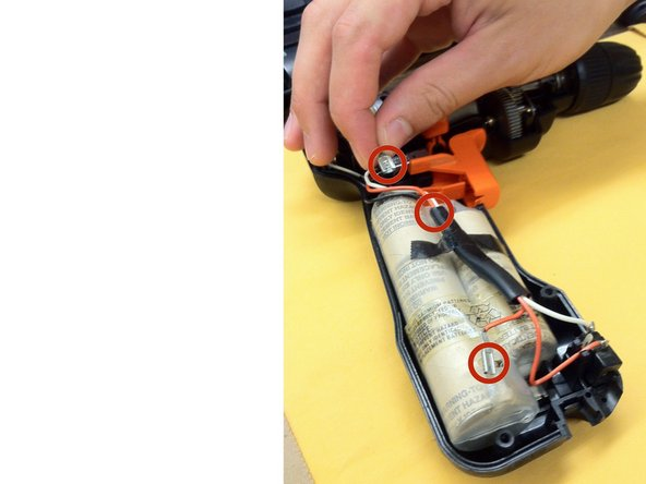 SHOCK WARNING: Ensure wire ends do NOT touch each other! Disconnect the battery from the drill by pulling out the 3 terminals.