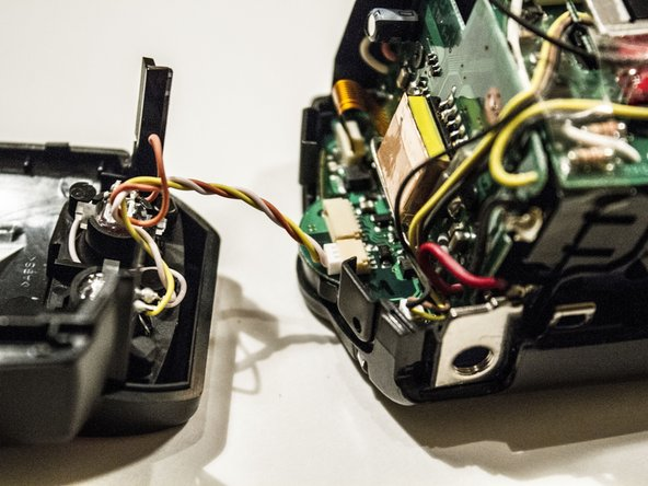 Re-attach the front casing wire for the infrared sensor.