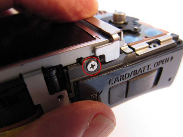 Remove a screw from the bottom of the LCD frame.