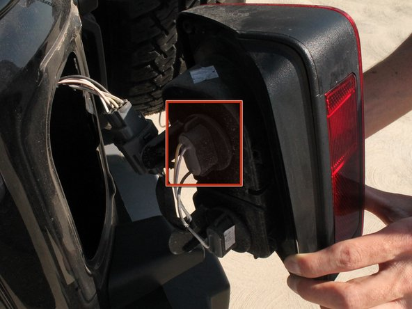 Locate the top light bulb on the back of the tail light casing. This is the bulb you are going to replace.