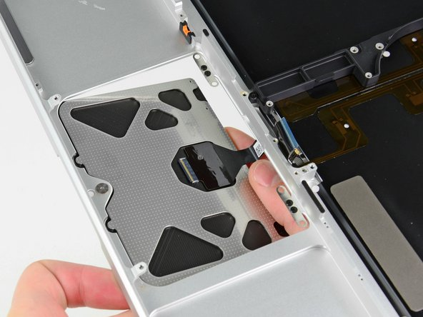 Carefully insert the cable from your old trackpad through its slot cut into your new upper case.