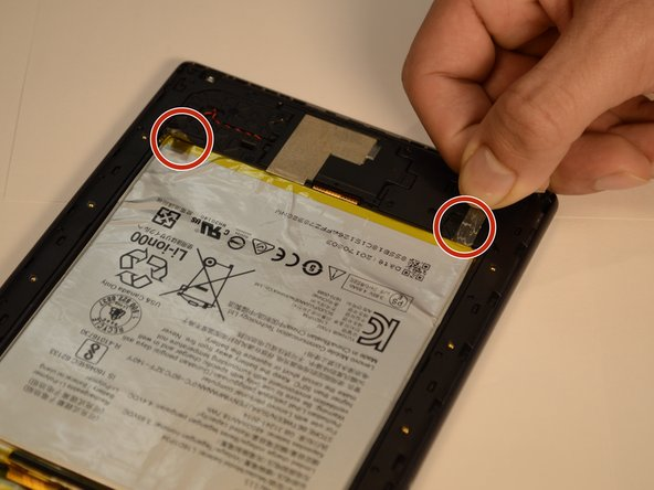 Gently pull on the two stretch release adhesive strips. Do not pull up, pull away from battery.