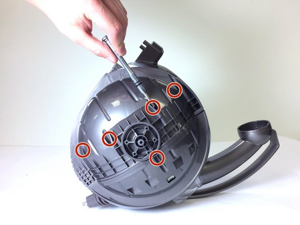 Locate and remove the five 22mm screws on each side of the ball that keep the plastic enclosure together using a T15 Torx bit.
