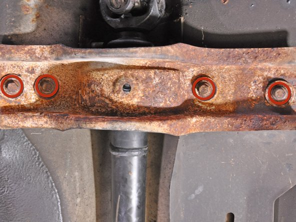 Support the drive shaft with a jack, jack stand, or other prop so it does not fall and get damaged or injure someone when the support is removed.