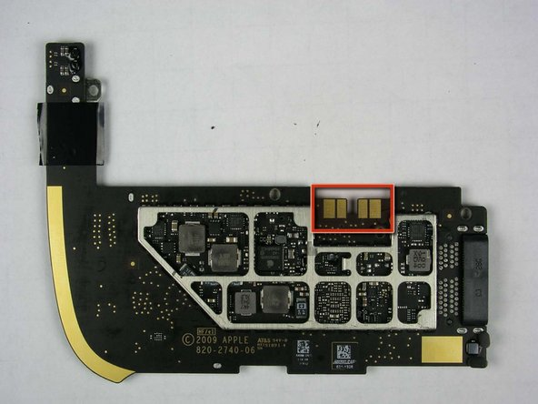 Bottom of logic board, with and without the EMI shield.