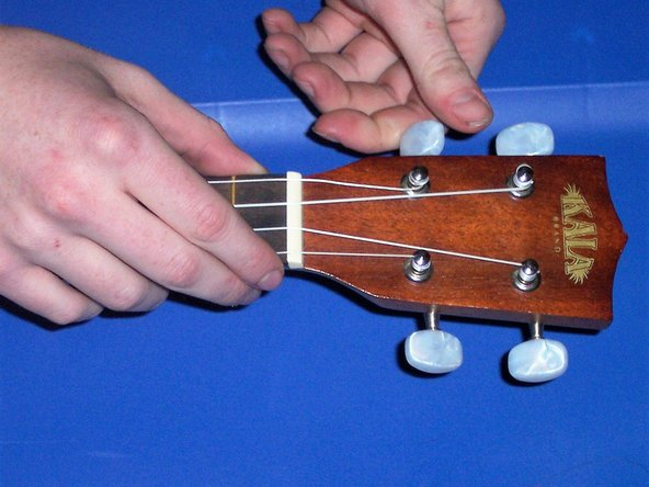 Start by loosening the string you are trying to replace by twisting  the pegs.