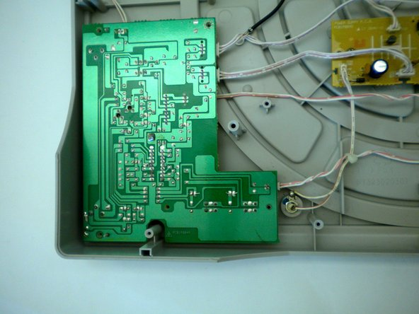Locate the largest circuit board inside the device.