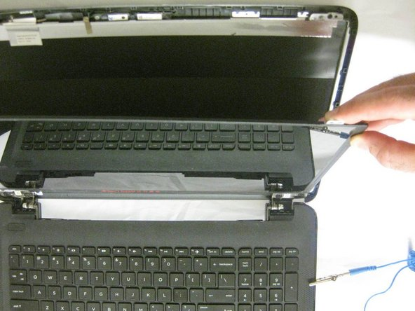 Carefully remove the screen and place it face down on the keyboard.