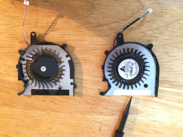 In my case the new fan (right) had a bit of white adhesive tape here - not good - that's going to collect every bit of dirt that goes through this fan!