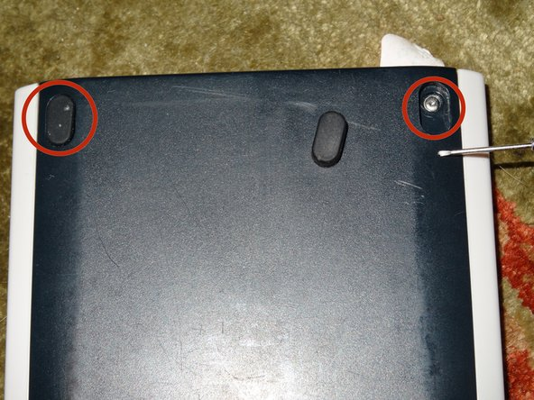 Remove the feet from the top of the calculator to reveal the top clutch screws.