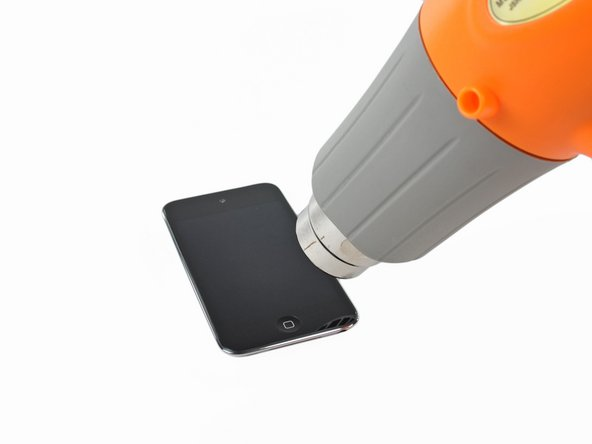 The iPod Touch 4th Generation front panel is attached to the rear case by adhesive. The use of a heat gun to soften the adhesive is highly recommended.