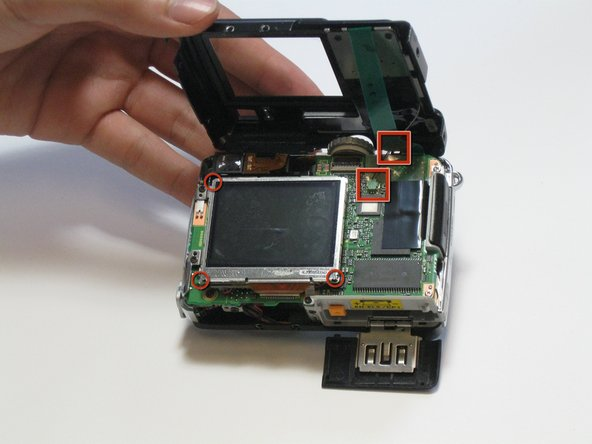 Carefully open the back cover. Take care as there are connectors still attached.