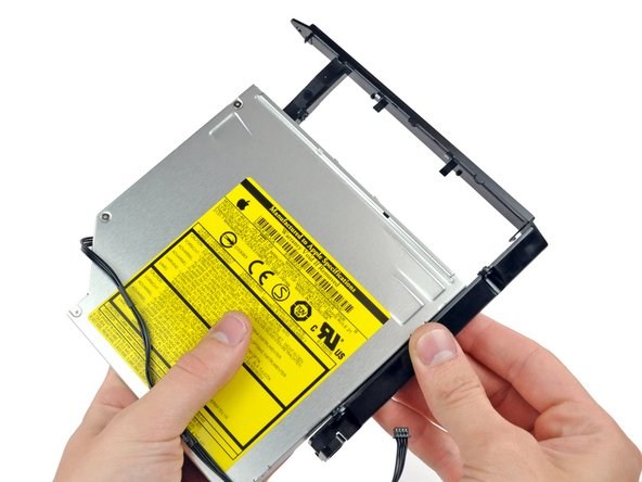 Pull the optical drive bracket toward the open end of the optical drive to free it from the optical drive.