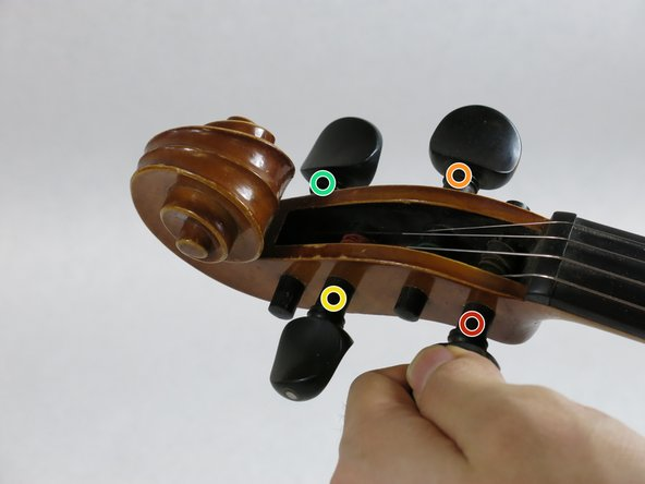 Loosen the strings gently starting with the G-string and the E-string, then the D-string and the A-string.