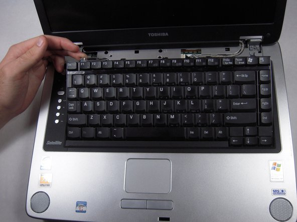 Use fingers to lift up the keyboard from the top.