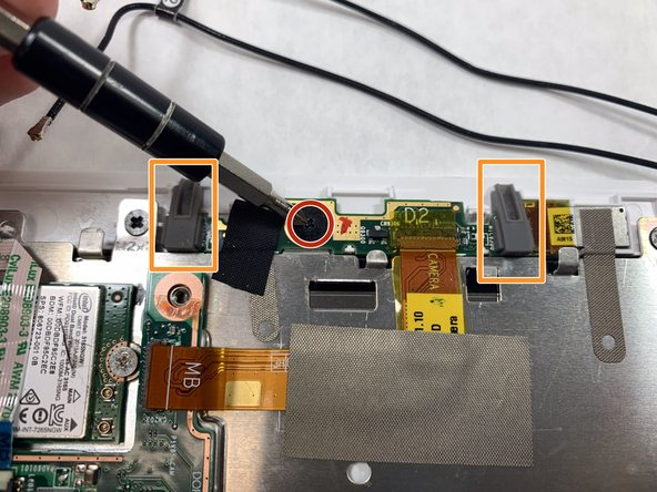 Using the Phillips #0 screwdriver, remove the 4.5mm screw from the camera circuit board.