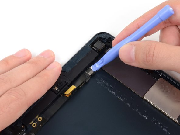 Gently pry the second (upper) metal plate up from the front-facing camera cable connector.