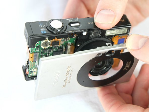 Remove the front cover by gently pulling it away from the camera body.