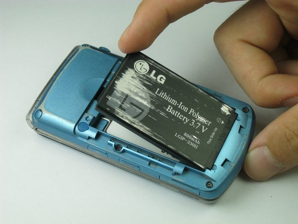 Using your index finger lift and remove the battery from the phone.