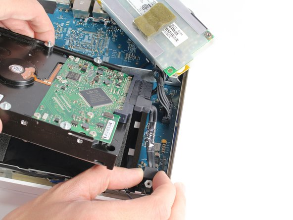 Remove the SATA connector and power connector from the end of the hard drive by simply pulling the cables straight away from the connection points.