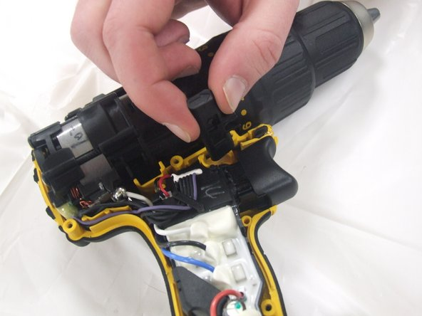 Disconnect the forward/reverse switch from the trigger by pulling the mechanism out and leaving the switch in the frame.