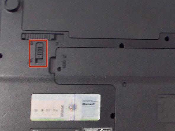 Slide the short slider one towards the unlocked lock symbol.