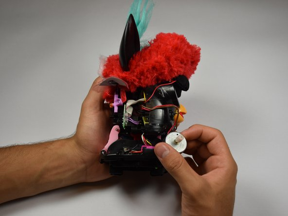 Orient Furby with the beak facing right.