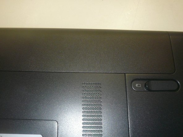 Turn off computer and remove the battery in the back side
