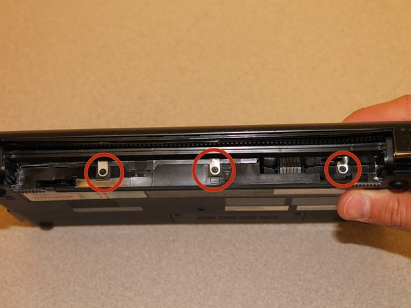 With the screen closed, turn your netbook around so that the battery slot is facing you.