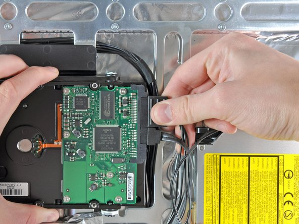 Disconnect the SATA data and power cables by pulling their connectors away from the hard drive.