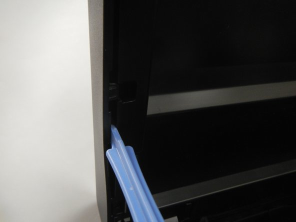 Using the blue plastic opening tool, pull from the middle and then slide back to remove the side panels.